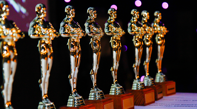 Oscar trophies lined up in a row